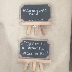 Two easel chalkboard signs